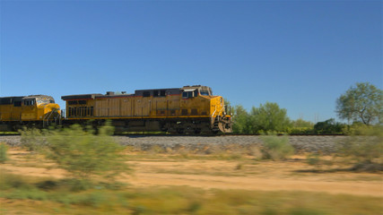 CLOSE UP: Long freight container train moving and transporting cargo