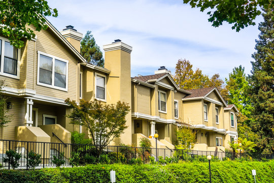 Residential buildings surrounded by trees and hedges; Sunnyvale, San Francisco bay area, California