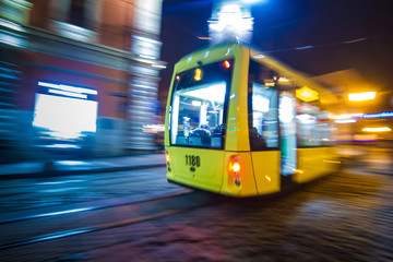 Lviv night blurred tram on historical beautiful streets with deep colorful light Fotomurales