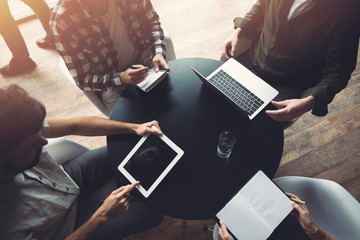Business people work together with laptop and tablet. Concept of teamwork and startup