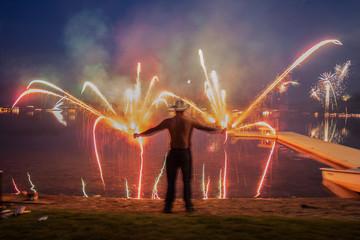 lighting fireworks at night