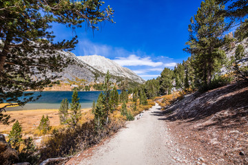 Hiking trail following the shoreline of Long Lake, Little Lakes Valley trail, John Muir wilderness, Eastern Sierra mountains, California