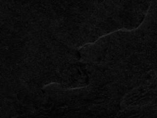 Dark grey or black slate background or texture.