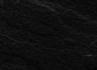 Black stone background or texture.