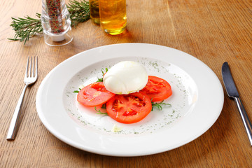 Mozzarella tomatoes and basil