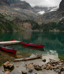 Two canoes in an alpine lake awaiting use high in the Canadian Rockies