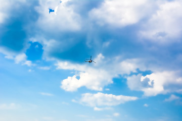 Bright blue sky with clouds and the helicopter