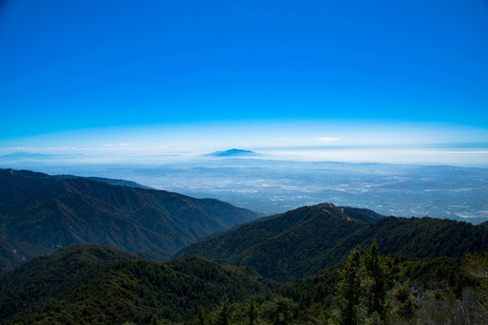 A panorama of the Los Angeles basin through the mist as seen from the San Gabriel Mountains in Cailofrnia
