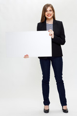 smiling woman in black business suit holding white board