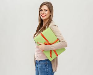 Smiling girl holding big gift box.
