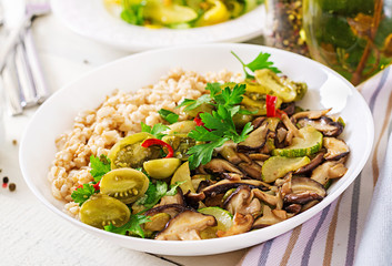 Diet menu. Healthy vegetarian meal - mushrooms shiitake, zucchini  and oatmeal porridge on bowl. Vegan food.