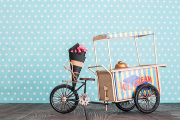 ice cream cart on wheels with bunch of flowers