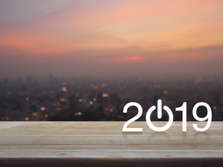 2019 start up business flat icon on wooden table over blur of cityscape on warm light sundown, Happy new year concept