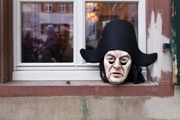 Basel carnival 2018. Andreasplatz, Basel, Switzerland - February 19th, 2018. Close-up of a single handmade beautiful carnival mask laying on a window sill