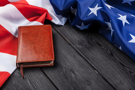 Bible laying on top of an american flag