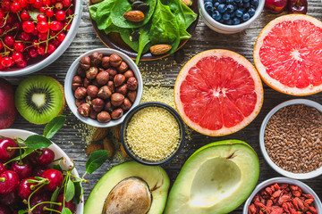 Healthy food on table. Breakfast in a bowls with super foods, vegetarian nutrition for health with fruits, vegetables and nuts