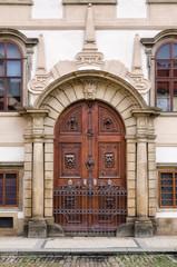 Decorative wooden door / Decorative carved wooden entry portal gate in Prague, Czech Republic