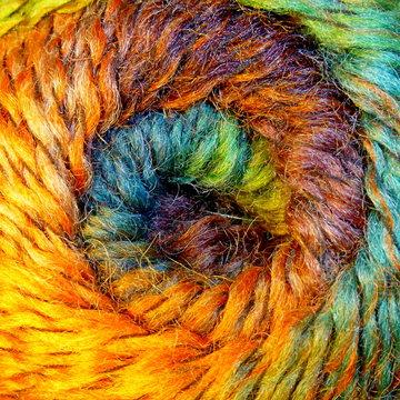 Skein of wool yarn. Macro shooting. Texture of wavy thread. Background image. Hobbies, leisure, crafts.