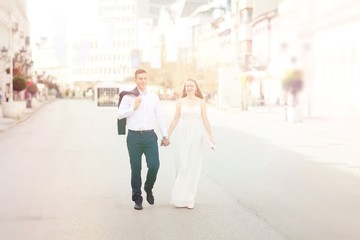 Romantic wedding of bride and groom celebrating marriage in the autumn in city.