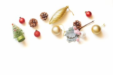 Flat lay Christmas photo. Traditional New Year decoration. Fir tree, red, gold balls, pine cones. Copy space