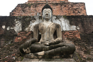 Buddha Statue at Wat Mahathat in Sukhothai Historical Park, Unesco world heritage. of Thailand .