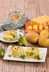 Potato gratins with broccoli florets.