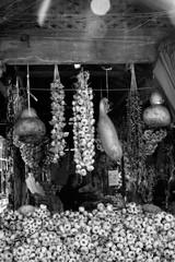 Hanging garlic for sale at Porto market (Mercado do Bolhao). Portugal