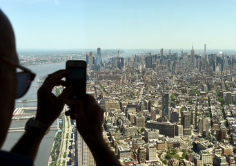 Man make a pictures on smartphone of the New York cityscape. Top view on the New York.