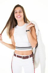 Attractive beauty girl in a white T-shirt and fashion coat, smiles and looks at the camera on white background
