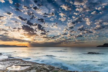 Floating Clouds and a Coastal Sunrise