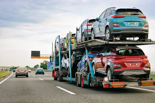 Cars carrier truck at asphalt highway road in Poland