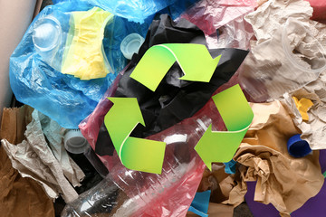 Different garbage with symbol of recycling. Ecology concept