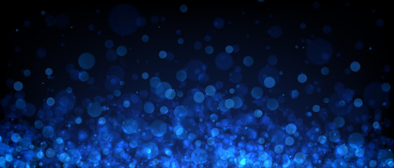 Blue abstract blurred background with bokeh effect.