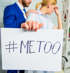 Share assault story. Discrimination assault complaint. Scandal sexual abuse victim. Assault at workplace. Assault targeted at employee. Girl hold poster hashtag me too while colleague calm down her
