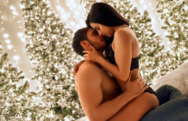 Sexy couple celebrating Christmas