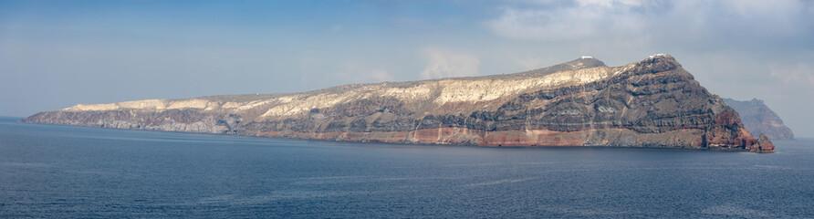 Panoramic view of Thirasia from sea next to Santorini, Greece