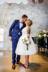 Newlywed couple kiss right after the ceremony