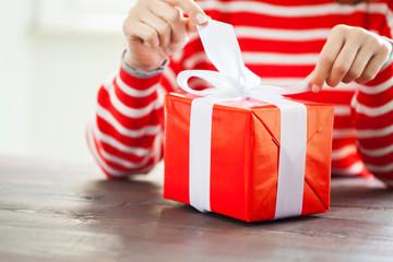 Female hands unpacking gift box