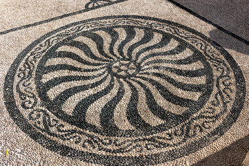 Traditional black and white pebbled mosaic for external paving of Agios Nicolao church - Chalki, Halki. Dodecanese Islands, Greece