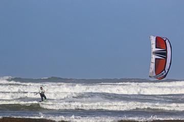 kitesurfer riding in breaking waves