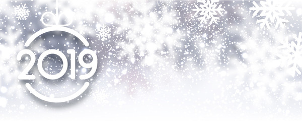 Grey blurred 2019 New Year banner with snowflakes.