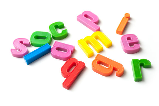 closeup of colorful plastic letters on white background