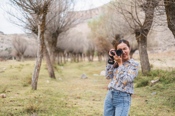 Front view Asian woman using camera  taking photo for landscape view photography