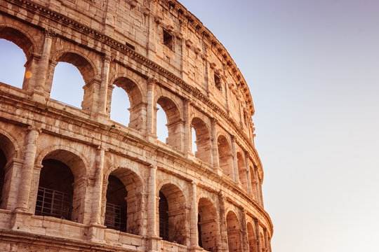 Scenic sunset over the Colosseum. Marble arches ruins over a blue sky, Rome, Italy