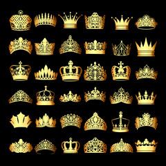 Illustration of a set of gold crowns on a black background