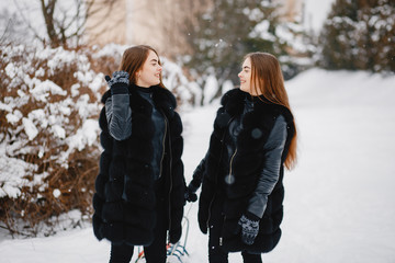 Girls in a winter park