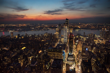 Poster - View of the night city and glowing skyscrapers from a height at sunset  New York. USA
