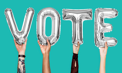 Silver gray alphabet balloons forming the word vote