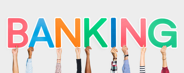 Hands holding up colorful letters forming the word banking