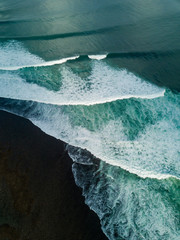 Indonesia, Bali, Aerial view of Uluwatu beach, breaking waves